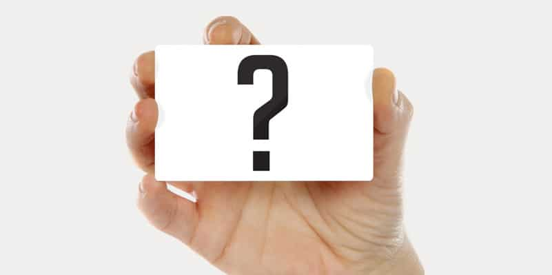 hand holding ID badge with question mark